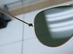 aviator gold sunglasses  gold metal frame green