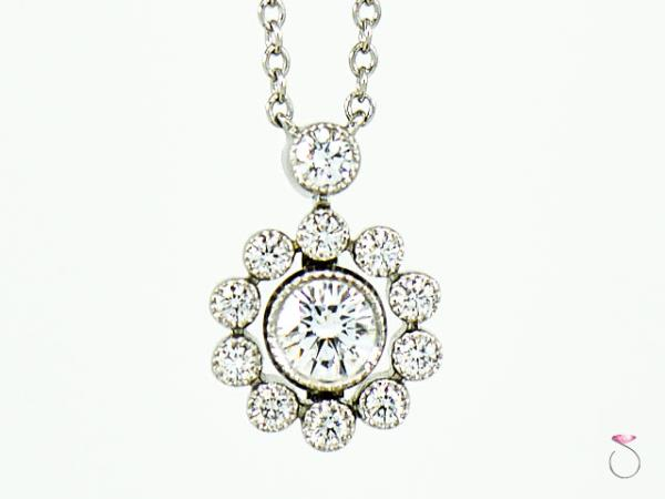 Tiffany co diamonds halo flower pendant necklace in platinum 16 solitaire jewelers guarantees the authenticity of all brand name designer and signed jewelry solitaire jewelers is not affiliated with any of those brands aloadofball Gallery