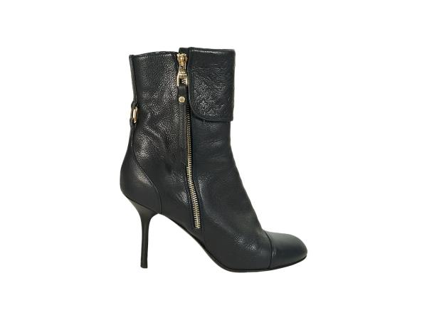 22e5016cd6e Product details  Navy blue leather ankle boots by Louis Vuitton. Monogram  embossed foldover shaft. Inner and outer zip closures. Round cap toe.