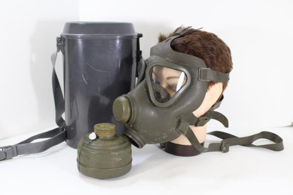 very cool gas mask with case canister etc does not include mannequin head would be a cool display item or maybe a piece for a halloween costume