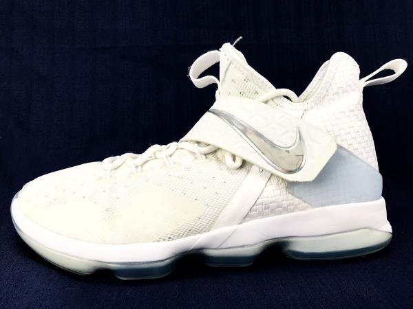 low priced ac78a a473a ... LeBron's fourteenth signature model receives a crisp white with an icy  clear outsole and iridescent Swooshes on the midfoot strap. Authenticity