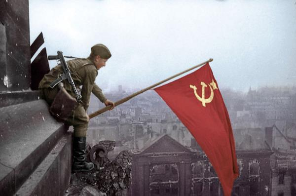 161-o 1945 Soldier Waves A Soviet Flag Over Berlin Photo