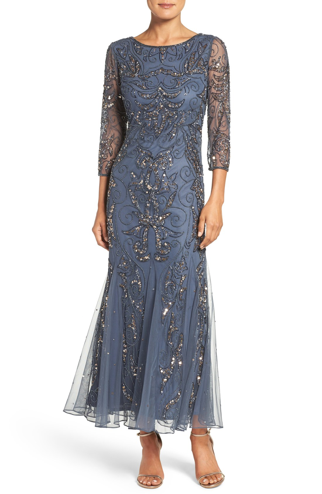 06fd74a7385 Thousands of glimmering beads and sequins sparkle around a mesh-veiled dress  designed with beautiful drape and flow accentuated by godets.