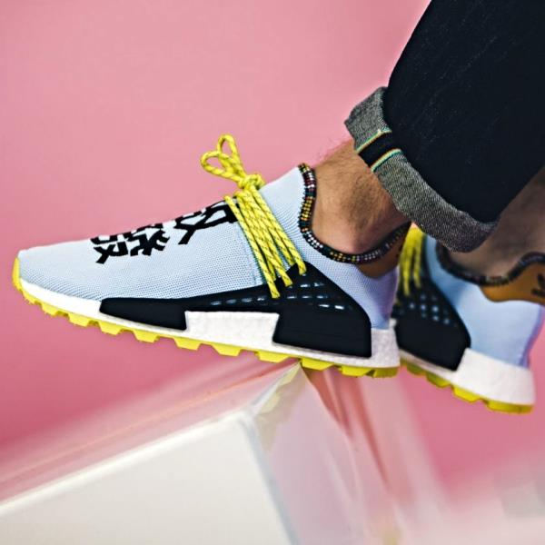 "9f2ba8a286c89 The Adidas Shoes For Men sees the socklike shoes take on a simple two-tone  black and white upper. The left shoe features ""Pharrell"" embroidery in white"
